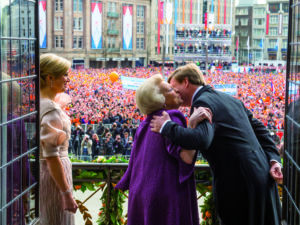 NETHERLANDS - APRIL 30: (NO ARCHIVE, NO SALE, EDITORIAL USE ONLY) In this handout image provided by RVD, HRH Princess Beatrix of the Netherlands kisses her son HM King Willem-Alexander of the Netherlands as HM Queen Maxima of the Netherlands looks on during a short address on the balcony of the Royal Palace to greet the public after the abdication of Queen Beatrix of the Netherlands and ahead of the inauguration of King Willem-Alexander of the Netherlands on April 30, 2013 in Amsterdam, Netherlands. (Photo by RVD/Jeroen Van Der Meyde/Getty Images)